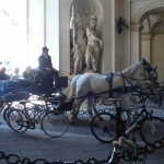 Riding through the arch to the palace of sissi